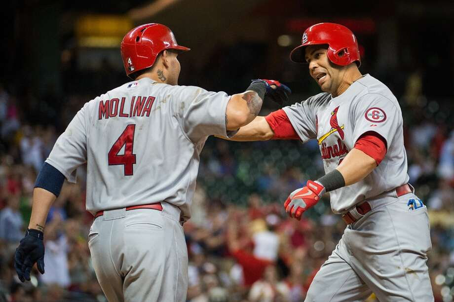 Cardinals right fielder Carlos Beltran celebrates with catcher Yadier Molina after hitting a home run during the sixth inning against the Astros.