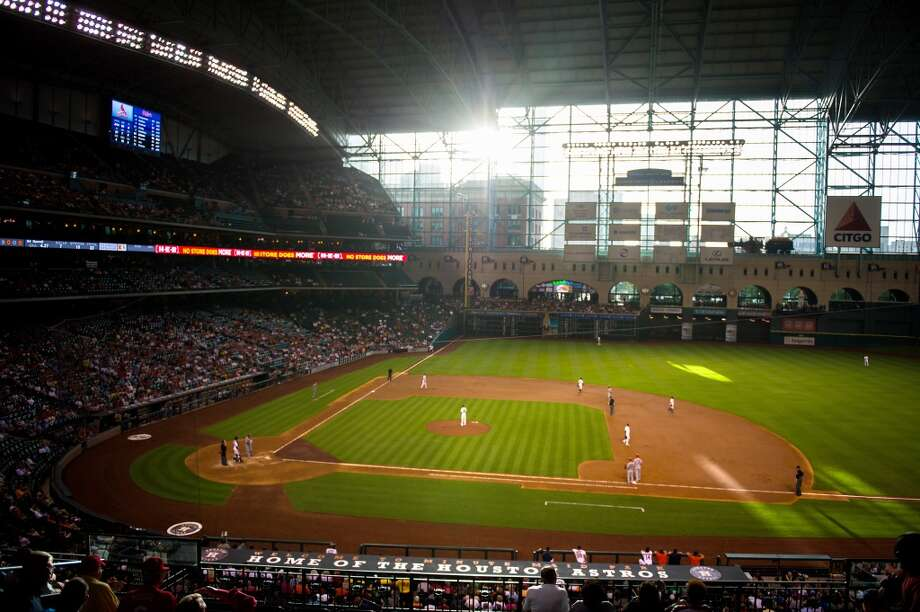 Sunlight streams into the stadium during the second inning as the Astros play the Cardinals
