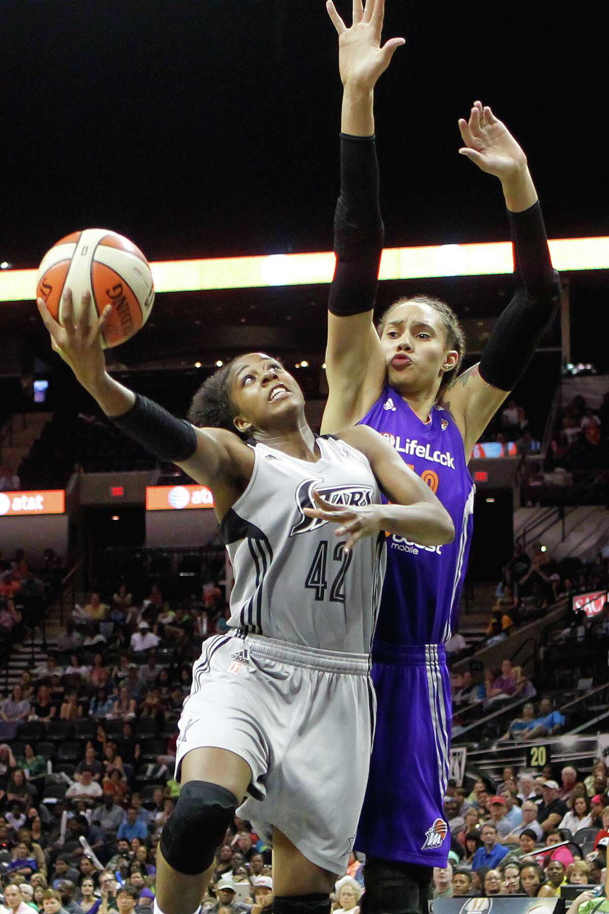 Phoenix's Brittney Griner (right) goes up to block a shot by Shenise Johnson during the second half of the Silver Stars game with the Phoenix Mercury at the AT&T Center on Tuesday, June 25, 2013. The game was former Baylor standout Brittney Griner's first trip to play in her home state. The Mercury won the game 83-77. MARVIN PFEIFFER/ mpfeiffer@express-news.net