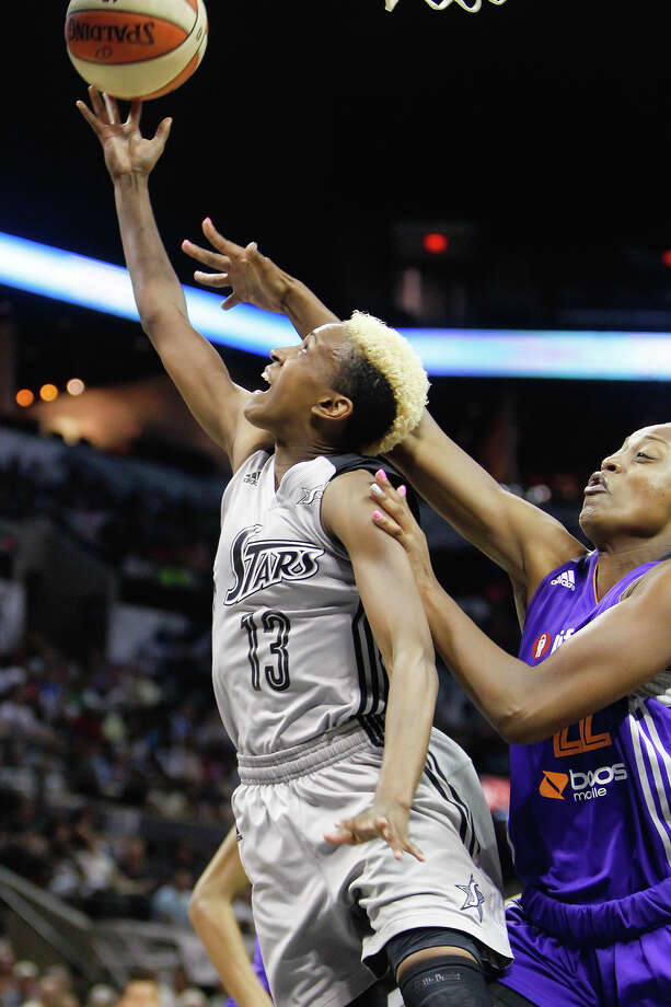 San Antonio's Danielle Robinson (left) goes up for a layup aroubd Phoenix's Charde Houston during the first half of the Silver Stars game with the Phoenix Mercury at the AT&T Center on Tuesday, June 25, 2013.  The game was former Baylor standout Brittney Griner's first trip to play in her home state.  Phoenix won the game 83-77.  MARVIN PFEIFFER/ mpfeiffer@express-news.net Photo: MARVIN PFEIFFER, Marvin Pfeiffer/ Express-News / Express-News 2013