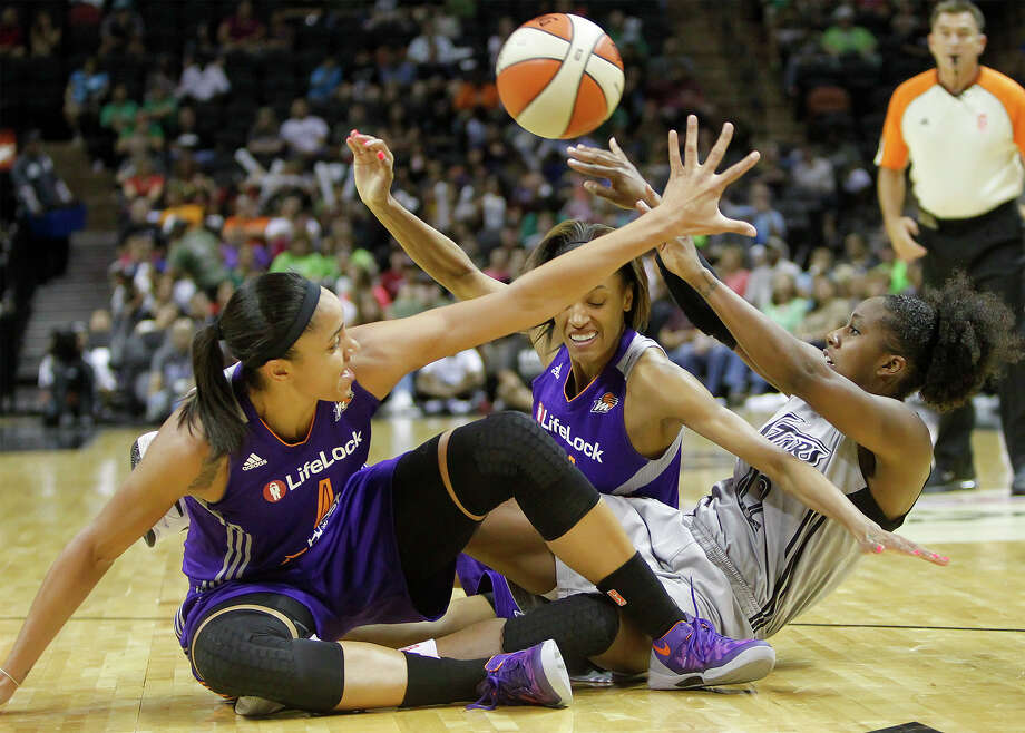 Shenise Johnson (from right) tries to pass the ball out after a scuffle with Phoenix's DeWanno Bonner and Candice Dupree during the first half of the Silver Stars game with the Phoenix Mercury at the AT&T Center on Tuesday, June 25, 2013.  The game was former Baylor standout Brittney Griner's first trip to play in her home state.  Phoenix won the game 83-77.  MARVIN PFEIFFER/ mpfeiffer@express-news.net Photo: MARVIN PFEIFFER, Marvin Pfeiffer/ Express-News / Express-News 2013