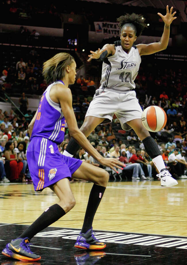 San Antonio's Shenise Johnson (right) loses the ball in front of Phoenix's DeWanna Bonner during the first half of theirgame at the AT&T Center on Tuesday, June 25, 2013.  The game was former Baylor standout Brittney Griner's first trip to play in her home state.  Phoenix won the game 83-77.  MARVIN PFEIFFER/ mpfeiffer@express-news.net Photo: MARVIN PFEIFFER, Marvin Pfeiffer/ Express-News / Express-News 2013