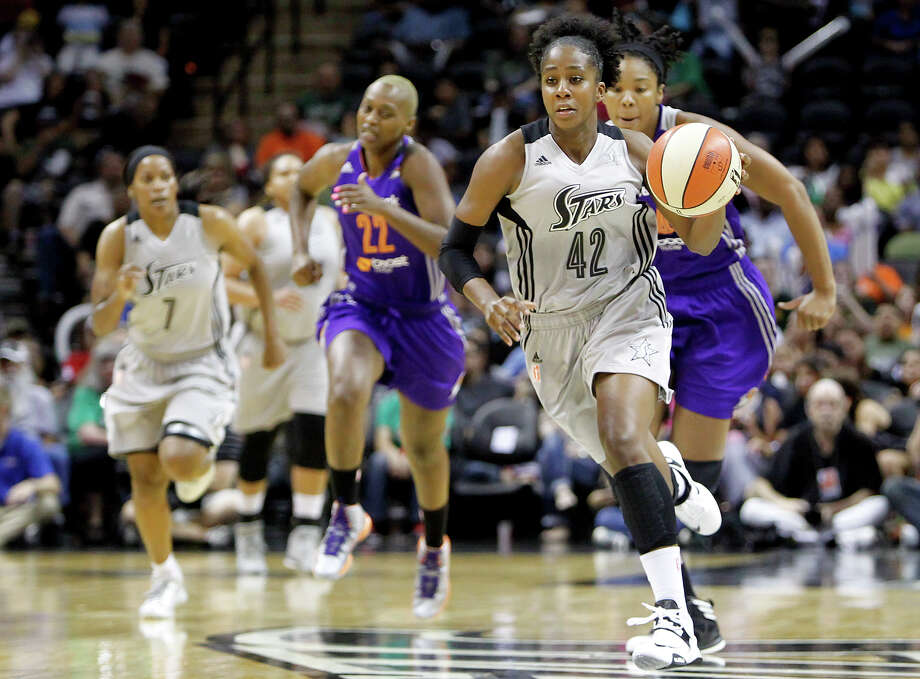San Antonio's Shenise Johnson brings the ball upcourt during the first half of the Silver Stars game with the Phoenix Mercury at the AT&T Center on Tuesday, June 25, 2013.  The game was former Baylor standout Brittney Griner's first trip to play in her home state.  The Mercury won the game 83-77.  MARVIN PFEIFFER/ mpfeiffer@express-news.net Photo: MARVIN PFEIFFER, Marvin Pfeiffer/ Express-News / Express-News 2013