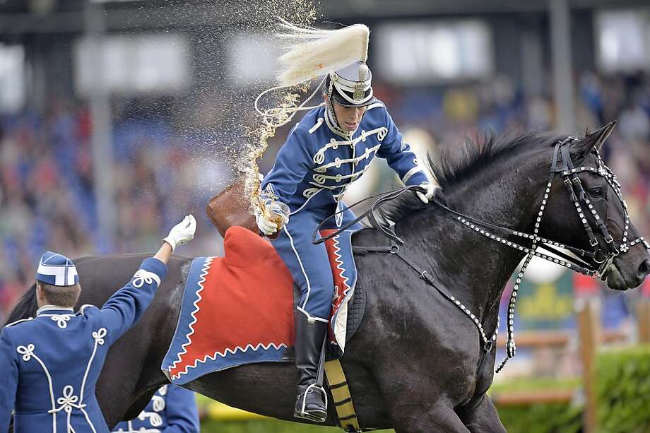 Sorry, I forgot to put a lid on your Coke:A comrade hands a drink to a Danish Guard 