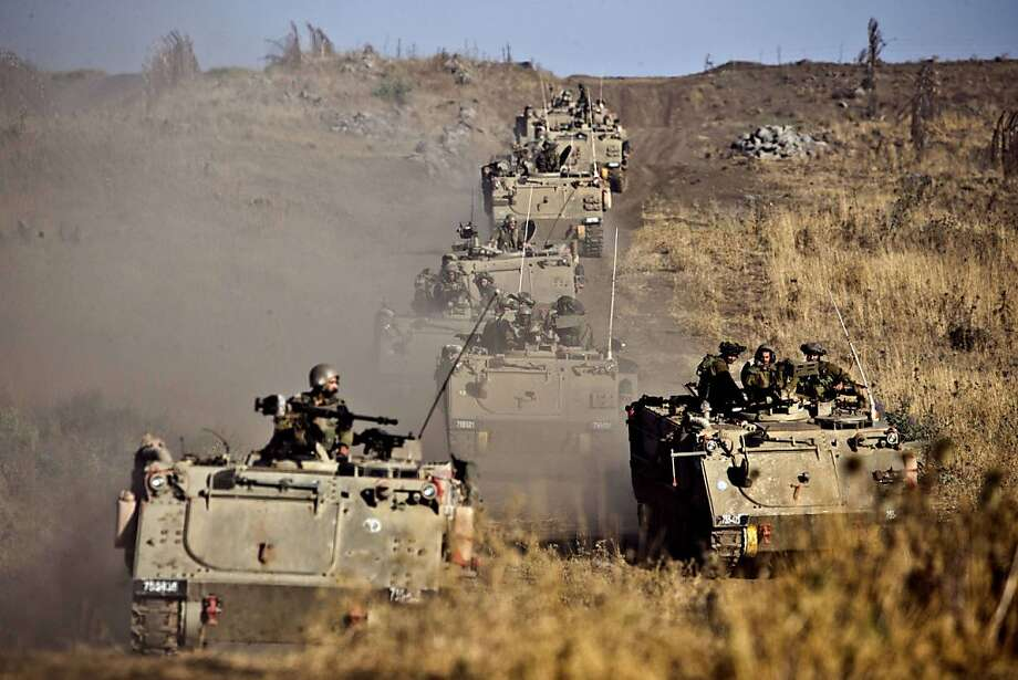 Israeli army Armored Personnel Carriers (APC) maneuver during a military exercise near the northern border with Syria on June 25, 2013 in the Israeli-annexed Golan Heights. AFP PHOTO / JACK GUEZJACK GUEZ/AFP/Getty Images Photo: Jack Guez, AFP/Getty Images