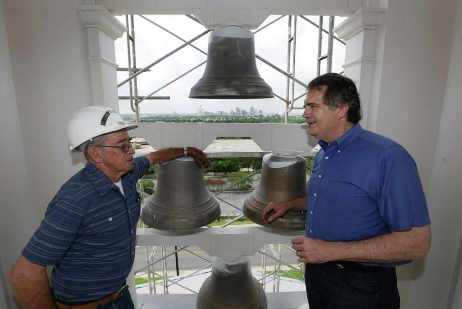 Pastor Les Hollon of Trinity Baptist Church, right, in the church's steeple talks with Bob Parker, a member and the contractor for the renovation of the iconic church steeple that can be seen from miles away, on Monday, June 24, 2013. Photo: Bob Owen, San Antonio Express-News / © 2012 San Antonio Express-News