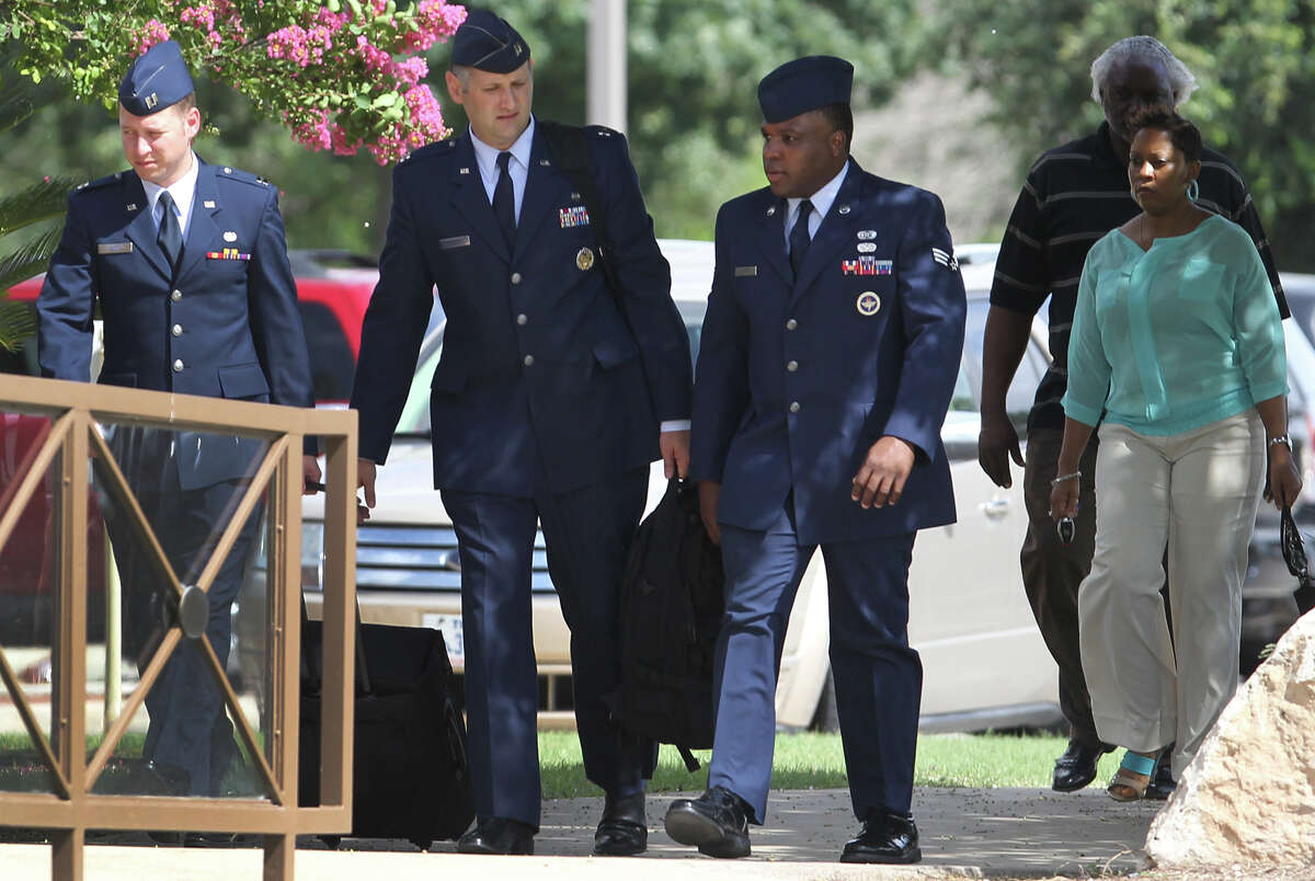 Senior Airman Christopher Oliver (third from left) walks Monday June 24, 2013 at Joint Base San Antonio-Lackland. Oliver is facing a court-martial on charges of aggravated sexual assault and abusive sexual conduct of one basic training recruit and other charges.