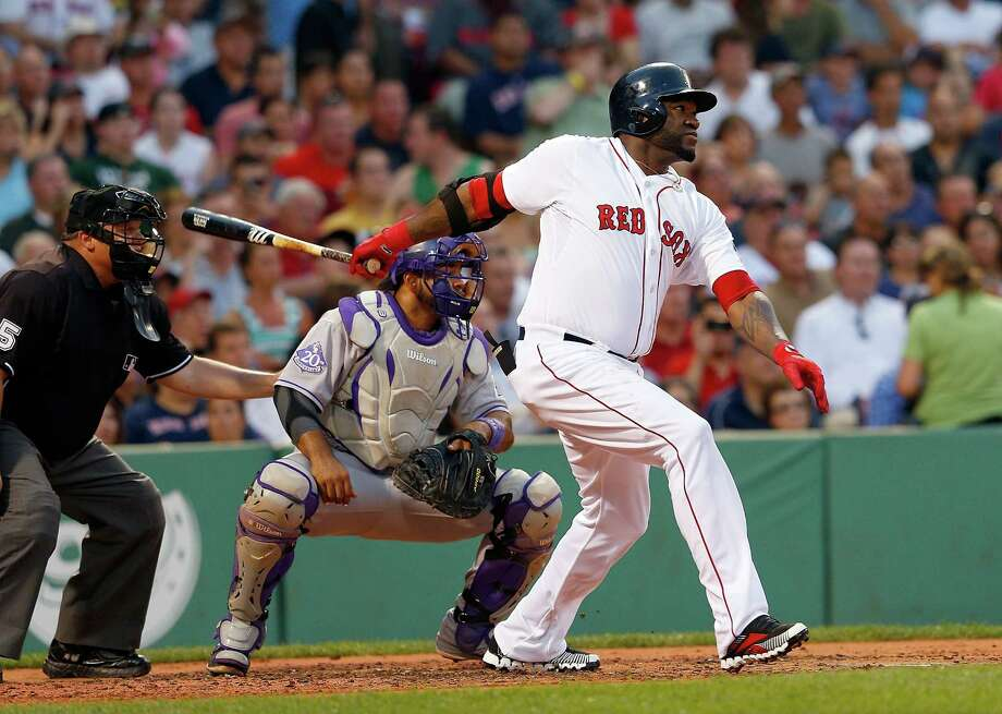 BOSTON, MA - JUNE 25: David Ortiz #34 of the Boston Red Sox doubles to knock in a run against the Colorado Rockies in the 2nd inning at Fenway Park on June 25, 2013 in Boston, Massachusetts.  (Photo by Jim Rogash/Getty Images) ORG XMIT: 163494254 Photo: Jim Rogash / 2013 Getty Images