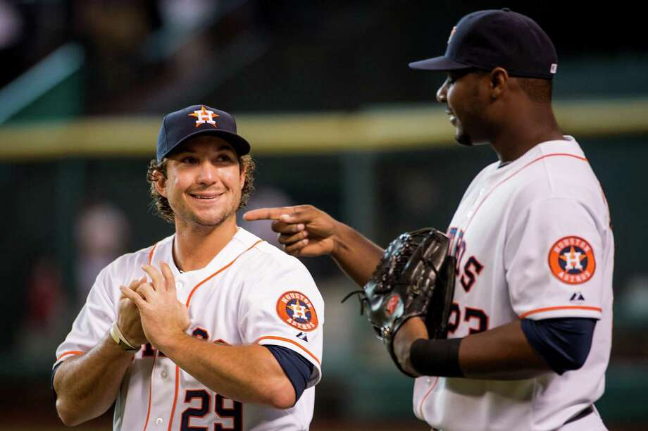 Brett Wallace, left, who was recalled from Oklahoma City, was all smiles about being back with teammates such as Chris Carter before Tuesday's game. Photo: Smiley N. Pool / © 2013  Smiley N. Pool
