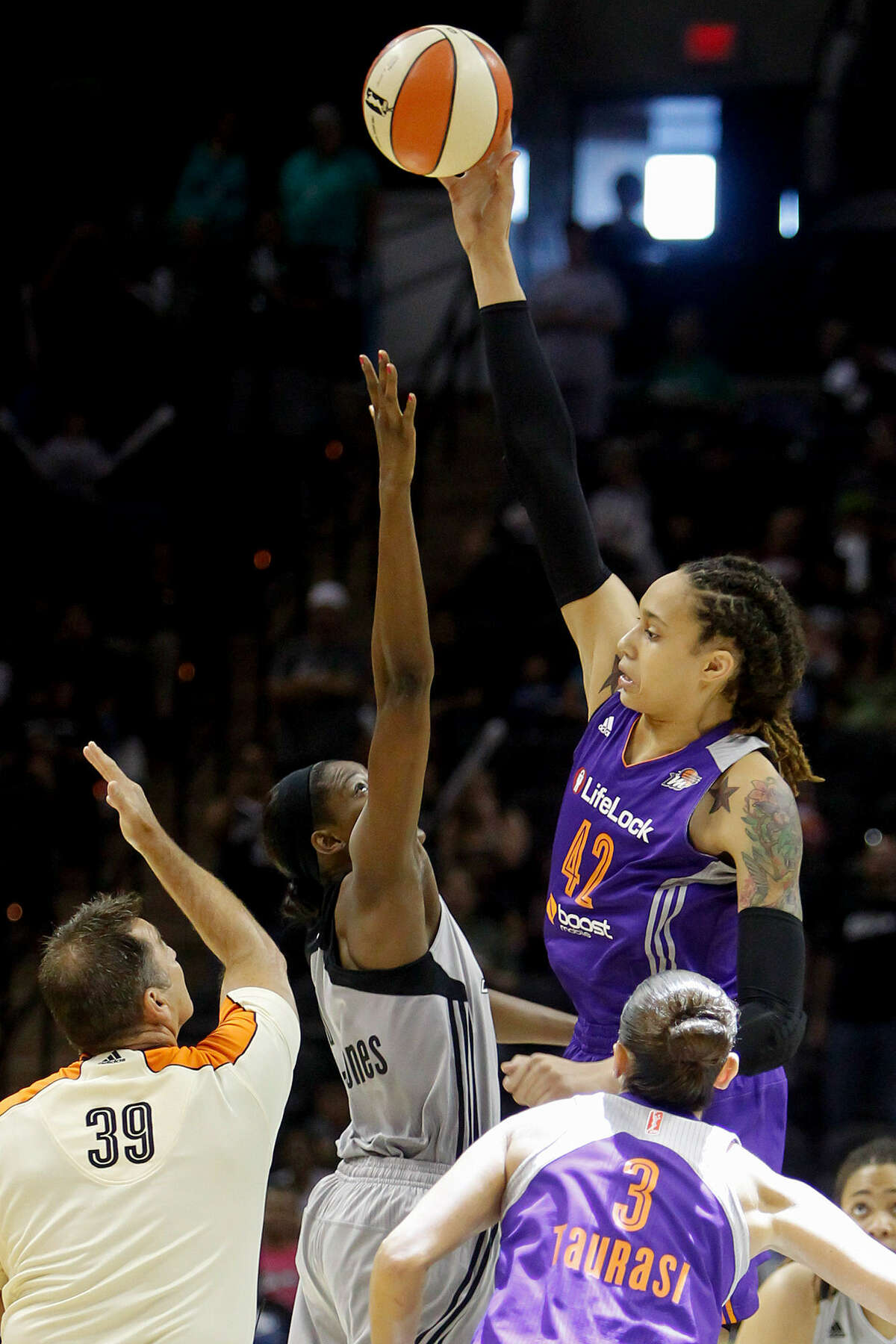 Phoenix center Brittney Griner controls the opening tip against the Silver Stars' DeLisha Milton-Jones. The ex-Baylor superstar had 26 points, seven rebounds and five blocks in her first WNBA game in San Antonio.