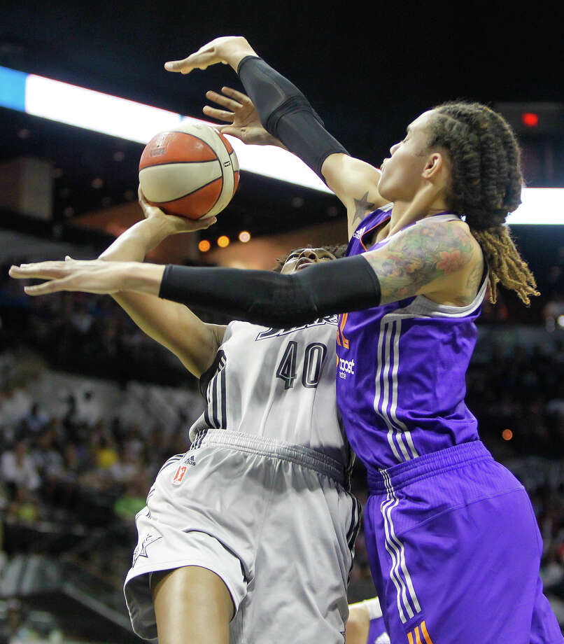 Brittney Griner of Phoenix (right) reaches to block a shot by the Silver Stars' Kayla Alexander during the first half of their game at the AT&T Center on Tuesday, June 25, 2013.  The game was former Baylor standout Brittney Griner's first trip to play in her home state.  Phoenix won the game 83-77.  MARVIN PFEIFFER/ mpfeiffer@express-news.net Photo: Marvin Pfeiffer/ Express-News / Express-News 2013