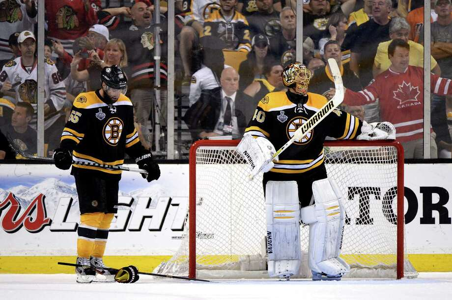 BOSTON, MA - JUNE 24: Tuukka Rask #40 of the Boston Bruins and Johnny Boychuk #55 of the Boston Bruins look on after the Chicago Blackhawks scored in the third period in Game Six of the 2013 NHL Stanley Cup Final at TD Garden on June 24, 2013 in Boston, Massachusetts.  (Photo by Harry How/Getty Images) Photo: Harry How