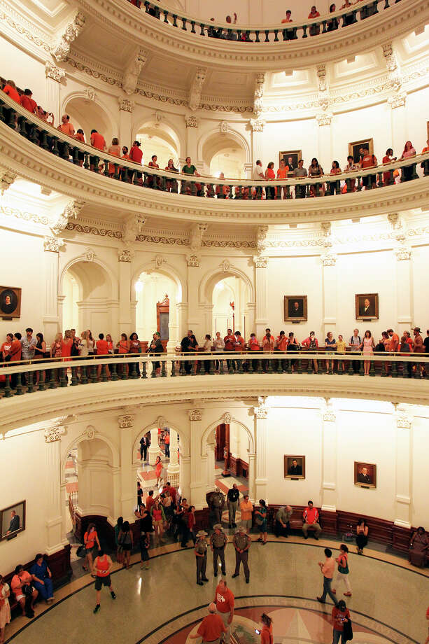 Spectators fill the capitol waiting for a turn to get into the Senate chamber as Fort Worth Senator Wendy Davis filibusters in an effort to cause abortion legislation to die without a vote on the floor of the Senate Tuesday, June 25, 2013. Photo: TOM REEL