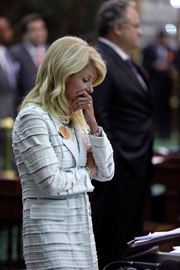 Fort Worth Senator Wendy Davis pauses after she is stopped late in the night  in her filibusters in an effort to cause abortion legislation to die without a vote on the floor of the Senate Tuesday, June 25, 2013. Photo: TOM REEL