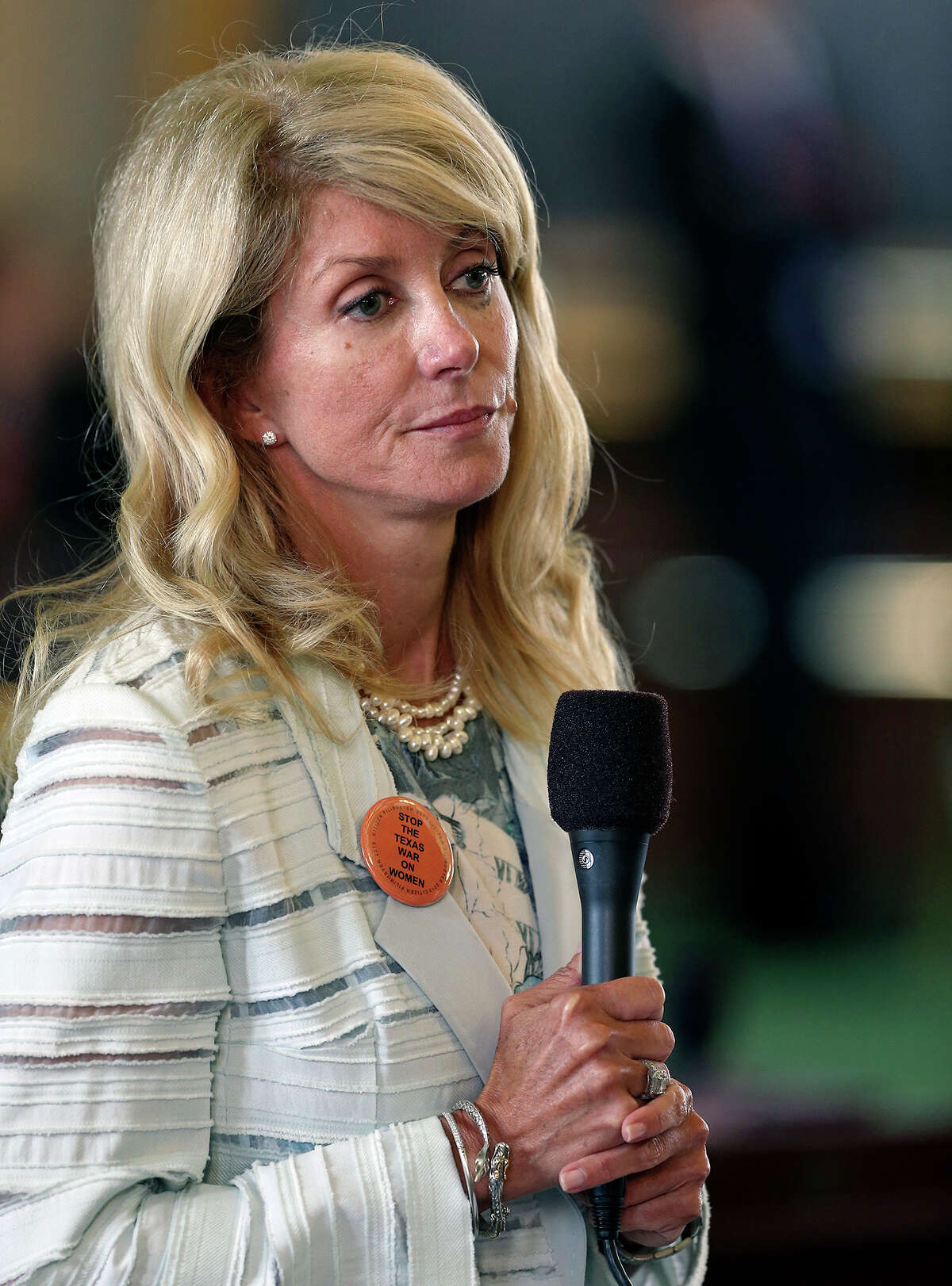 Fort Worth Senator Wendy Davis shows signs of fatigue as she filibusters in an effort to cause abortion legislation to die without a vote on the floor of the Senate Tuesday, June 25, 2013.