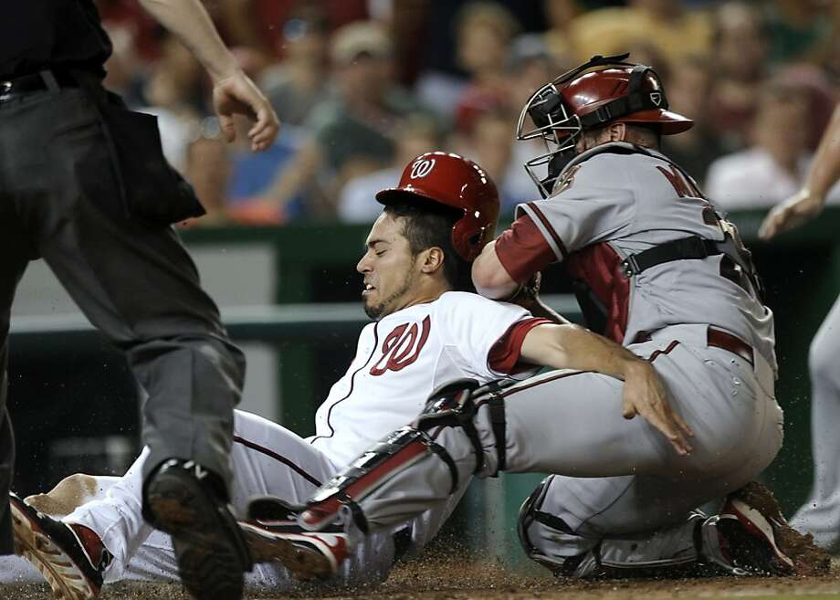 Washington Nationals' Anthony Rendon, left, is tagged out by Arizona Diamondbacks catcher Miguel Montero right, during the seventh inning of a baseball game at Nationals Park in Washington, Tuesday, June 25, 2013. The Nationals won 7-5. (AP Photo/Susan Walsh) Photo: Susan Walsh, Associated Press