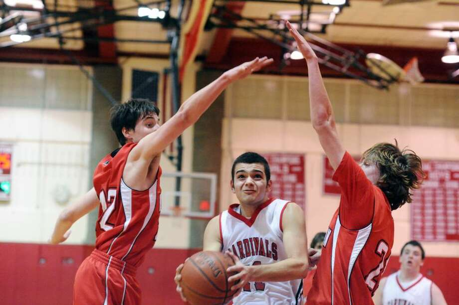 Greenwich's Brian Leeds breaks through the New Canaan defense as Greenwich High hosts New Canaan in a boys basketball game Friday evening, January 15, 2010. Greenwich won 41-40. Photo: Keelin Daly / Greenwich Time