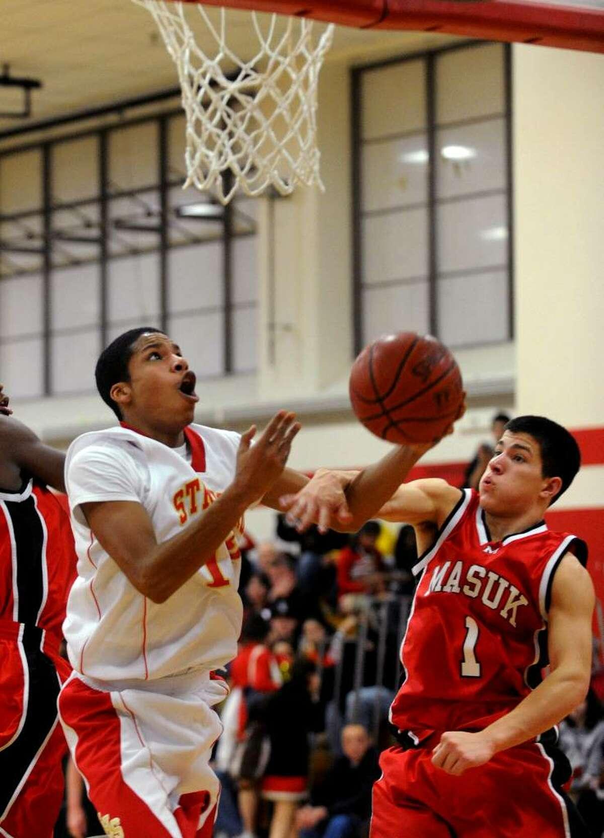 Masuk's #1 Anthony Delorenzo, right, blocks Stratford's #12 Russell Payton, during basketball action in Stratford, Conn. on Friday Jan. 15, 2010.