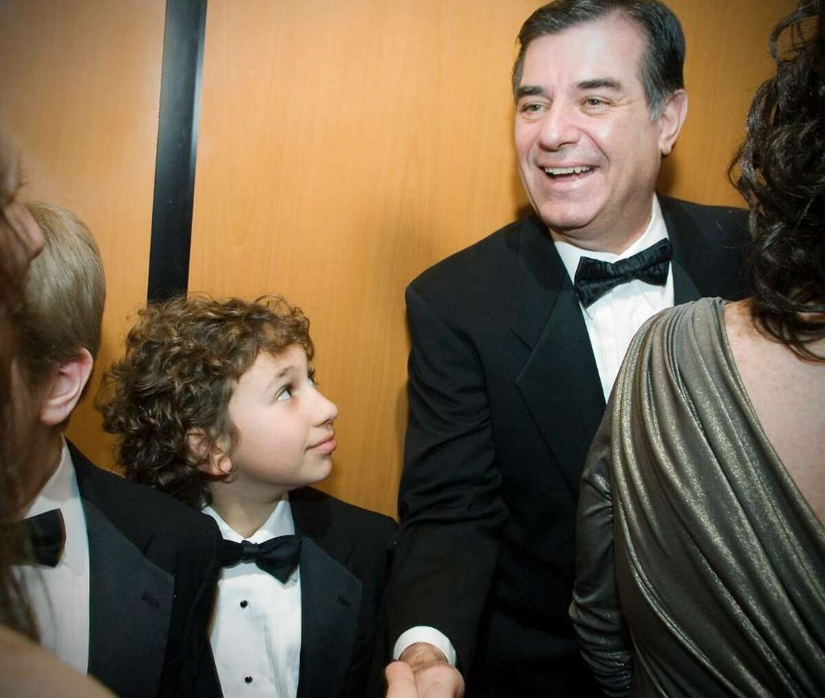 """Mayor Pavia greets guests in the elevator as Evan Hyman, 10 of Stamford, jumps in for the ride at """"A Thousand Stars Shine Together"""", A Gala Inaugural Celebration at The Palace Theater in Stamford, Conn. on Friday, January 15, 2009."""
