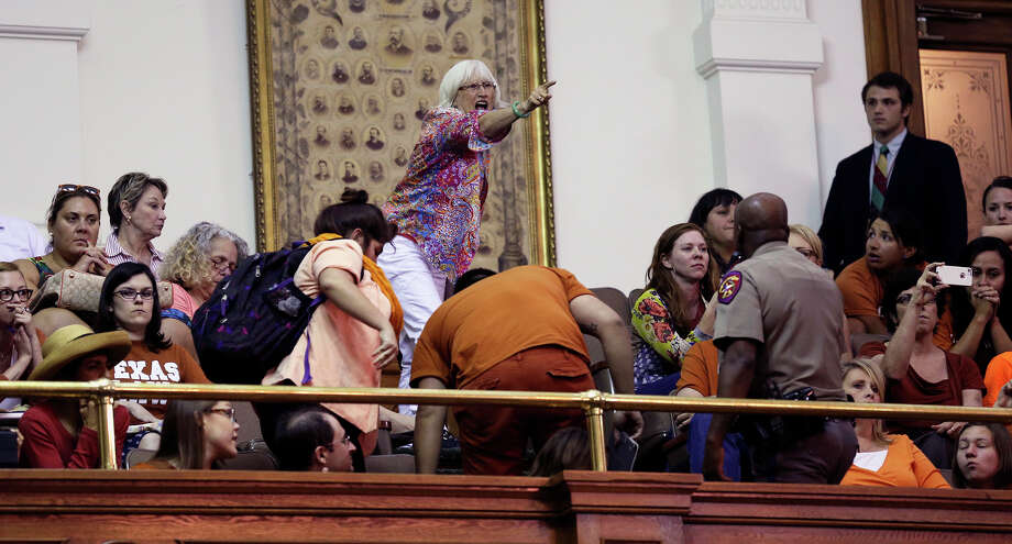"Senate debate on abortion crossed many linesIn those tense, thickly ticking moments before midnight, all many of us on the ground floor of the Texas Senate could do was marvel gape-mouthed at the scene a floor above, one we knew we'd likely never see again.Hundreds of Texans who had filled the gallery throughout the day to ""Stand With Wendy"" in the Fort Worth Democratic senator's pink-sneakered, 11-hour filibuster of a restrictive abortion bill were now themselves on their feet, chanting, yelling, applauding with a roar so deafening that they had drowned out parliamentary debate below. Read the rest of the column at HoustonChronicle.com.A spectator shouts in the chamber as Wendy Davis is stopped during her filibuster in an effort to cause abortion legislation to die without a vote on the floor of the Senate, June 25, 2013. Photo: TOM REEL"