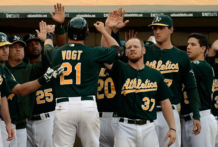 Catcher Stephen Vogt, called up Tuesday from Sacramento, is congratulated after he got his first major-league RBI with a sacrifice fly in the second inning. Photo: Thearon W. Henderson, Getty Images