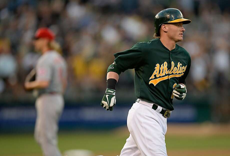 OAKLAND, CA - JUNE 25:  Josh Donaldson #20 of the Oakland Athletics trots around the bases after hitting a two-run homer as pitcher Bronson Arroyo #61 of the Cincinnati Reds looks on in the third inning at O.co Coliseum on June 25, 2013 in Oakland, California.  (Photo by Thearon W. Henderson/Getty Images) Photo: Thearon W. Henderson, Getty Images