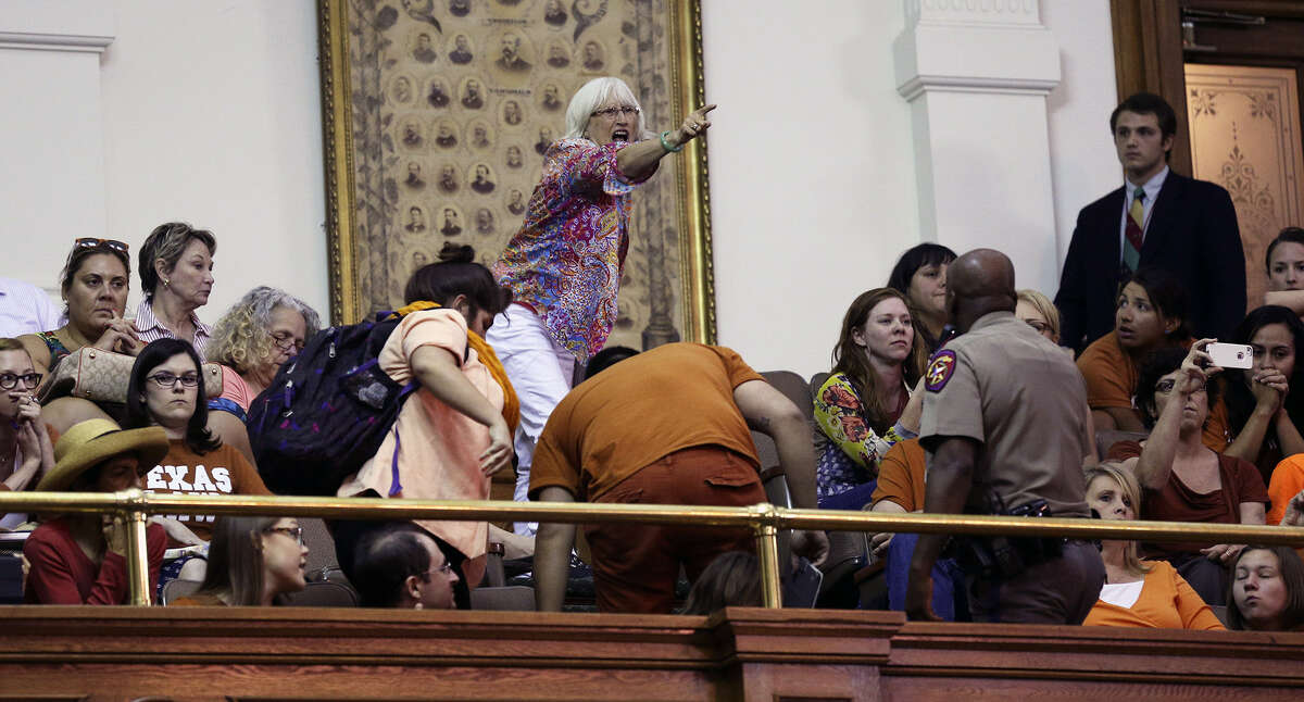 A spectator shouts in the Senate chamber as Fort Worth Sen. Wendy Davis is stopped in her filibuster in an effort to cause abortion legislation to die.