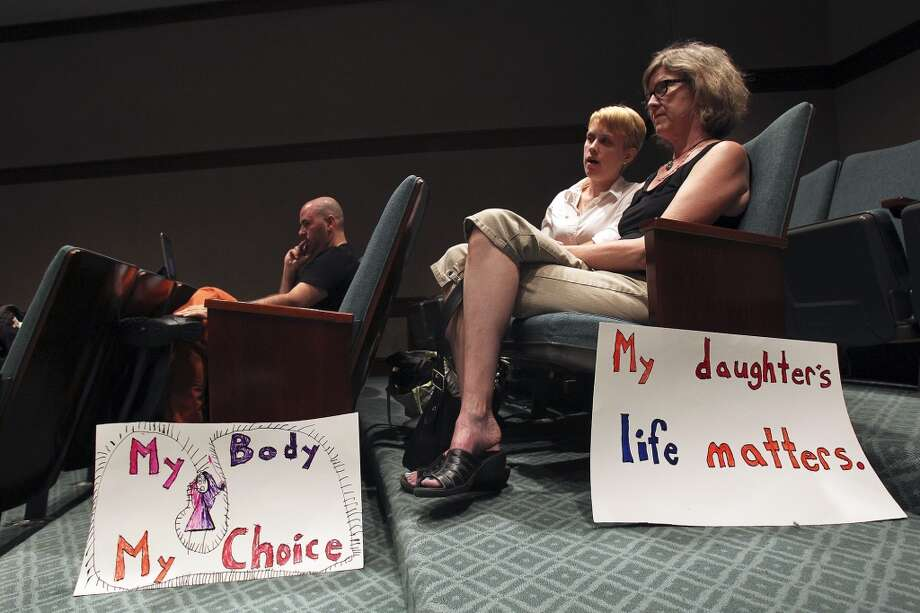 Kathy Bylenok watches with her daughter Tasha Bylenok in an overflow room for spectators. Photo: TOM REEL