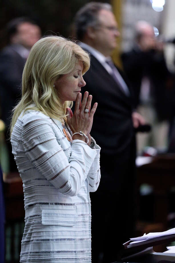 Fort Worth Senator Wendy Davis gestures after she was stopped in her filibuster in an effort to cause abortion legislation to die without a vote on the floor of the Senate Tuesday, June 25, 2013. Photo: TOM REEL
