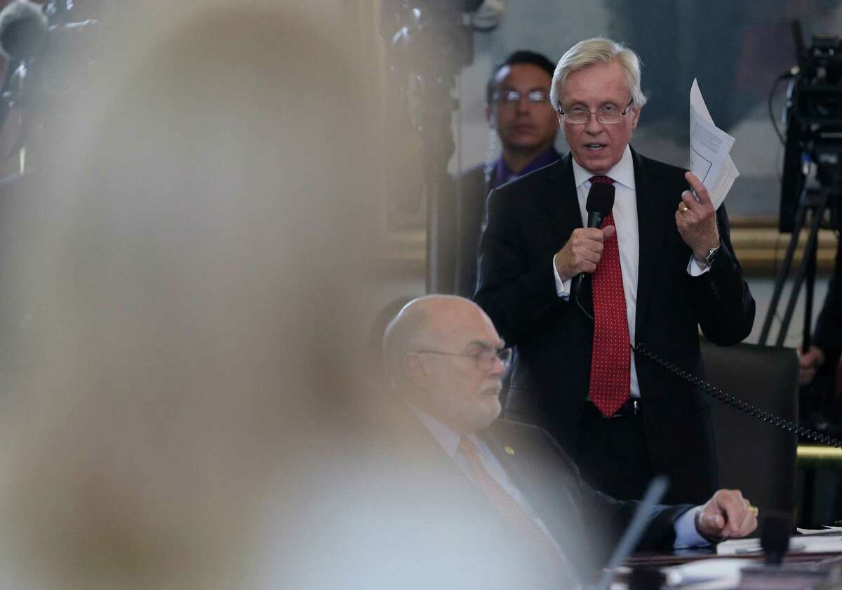 Former Sen. Robert Deuell, R-Greenville, right, questions ex-Sen. Wendy Davis, D-Fort Worth, left, as she filibusters an abortion bill on June 25, 2013, in Austin, Texas. Deuell, who lost in the 2014 Republican primary to a tea party opponent, has been embroiled in a legal fight with an anti-abortion group. (AP Photo/Eric Gay)