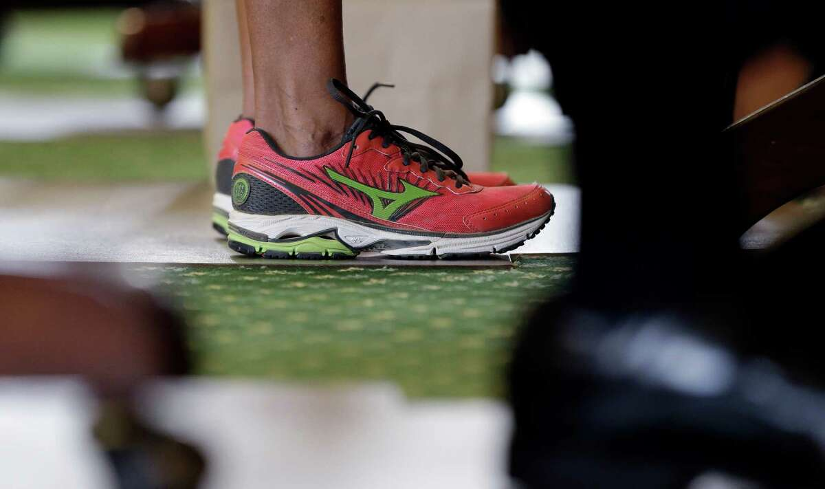 Wendy Davis' pink sneakers - Sen. Wendy Davis, D-Fort Worth, rocks the pink sneakers for both comfort and to make a political statement during her filibuster at the Texas Capitol. (AP Photo/Eric Gay)
