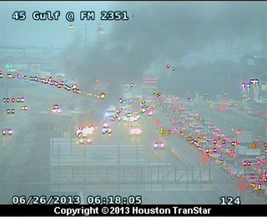Traffic was slowed on the Gulf Freeway near Dixie Farm Road after a vehicle fire early Wednesday morning. Photo: Houston Transtar