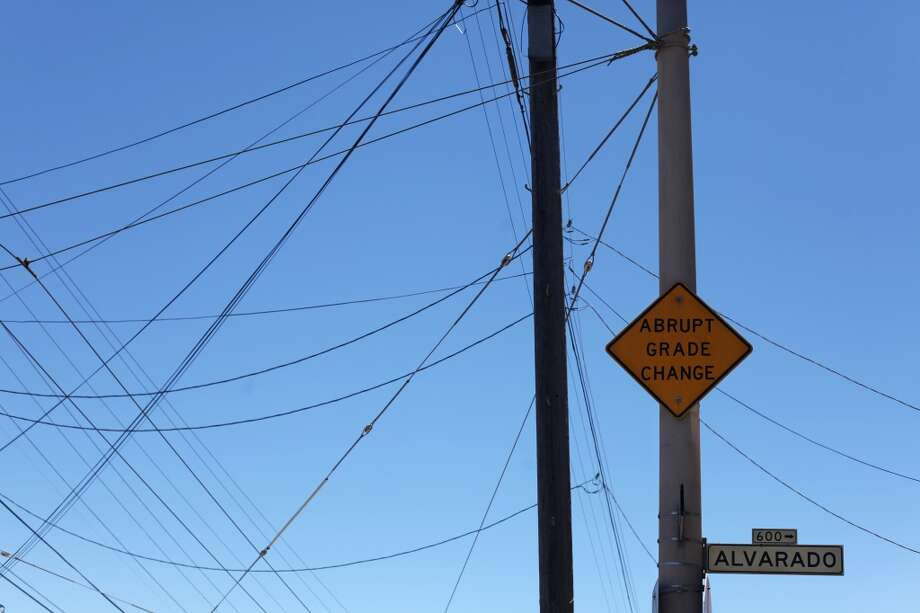 Electric wires and a grade change sign are seen at the intersection of Noe and Alvarado Streets on Castro Hill on June 21, 2013 in San Francisco, Calif.