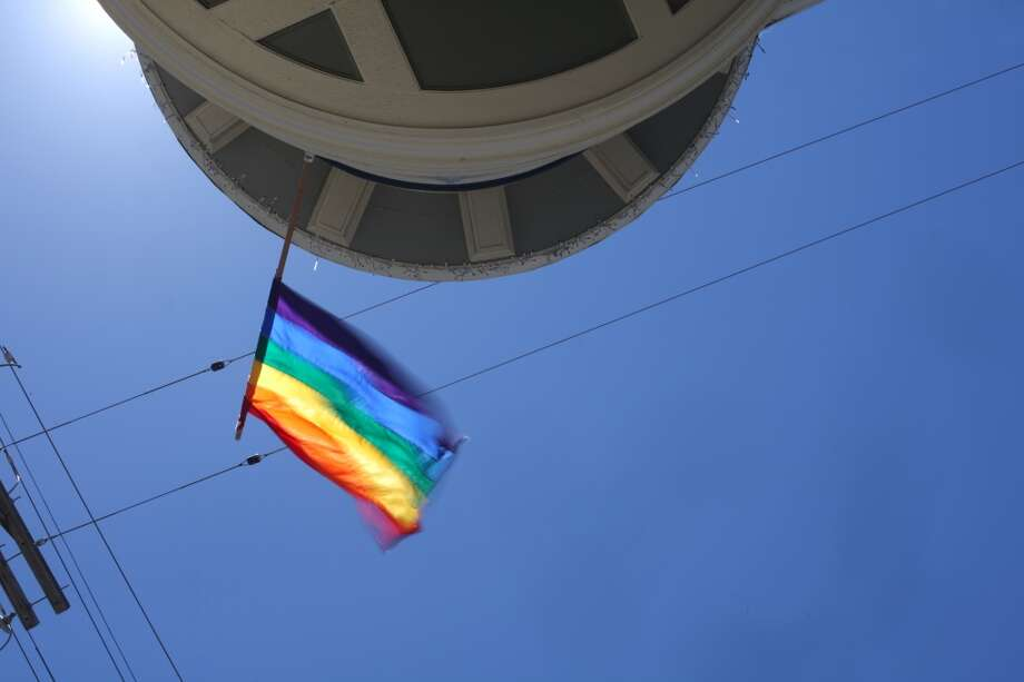 A rainbow flag is seen on a building at the intersection of Castro and 23rd Streets on Castro Hill on June 21, 2013 in San Francisco, Calif.
