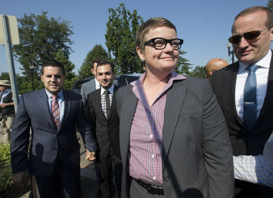 Plaintiffs in the California Proposition 8 case, Kris Perry, center, from Berkeley, Calif., with Jeff Zarrillo, far left, and Paul Katami, second from left, arrive at the Supreme Court in Washington, Tuesday, June 25, 2013, as key decisions are expected to be announced.  At far right is Chad Griffin, president of the Human Rights Campaign. (AP Photo/J. Scott Applewhite)