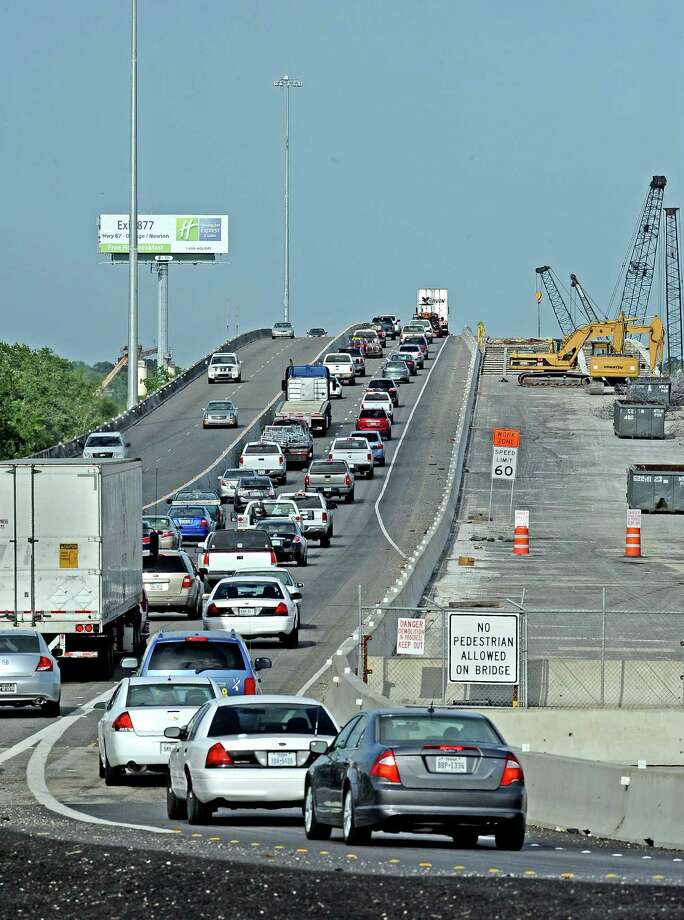 As construction continues on the Purple Heart Memorial Bridge in Beaumont traffic trickles through, but not with a few problems.  With the merging traffic and fast moving vehicles traffic collisions have become quite an issue.  Photo taken Tuesday, June 25, 2013. Photo taken: Randy Edwards/The Enterprise