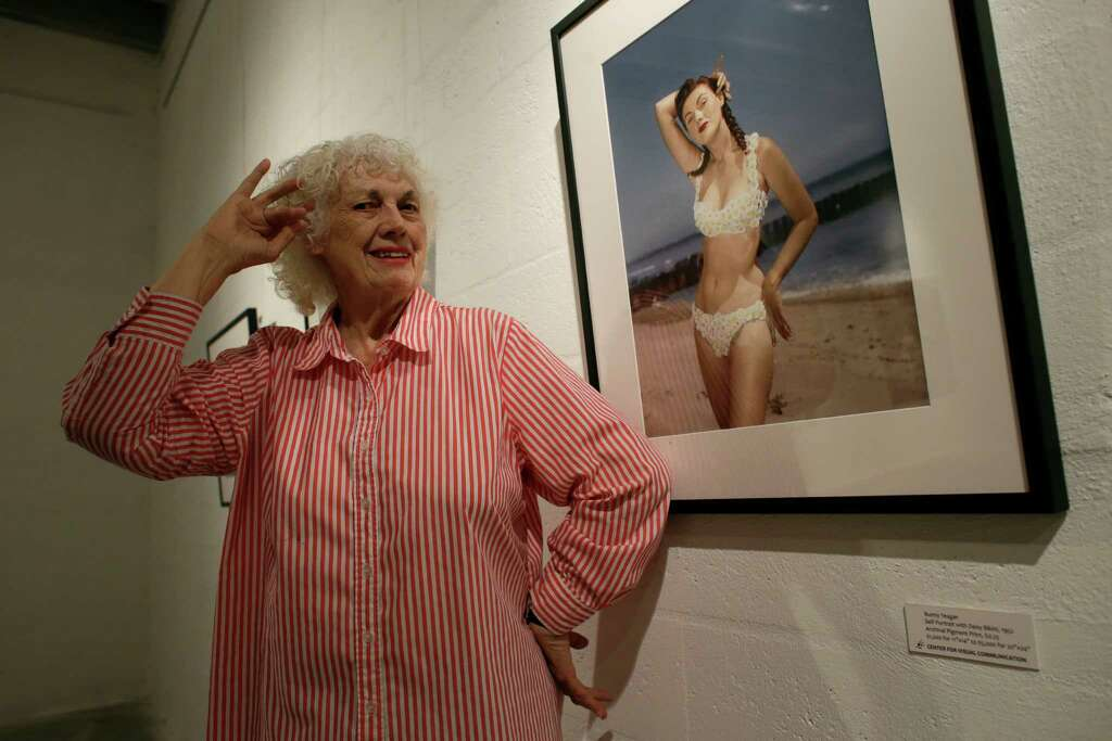 In this Tuesday, April 23, 2013 photo, photographer Bunny Yeager poses next  to