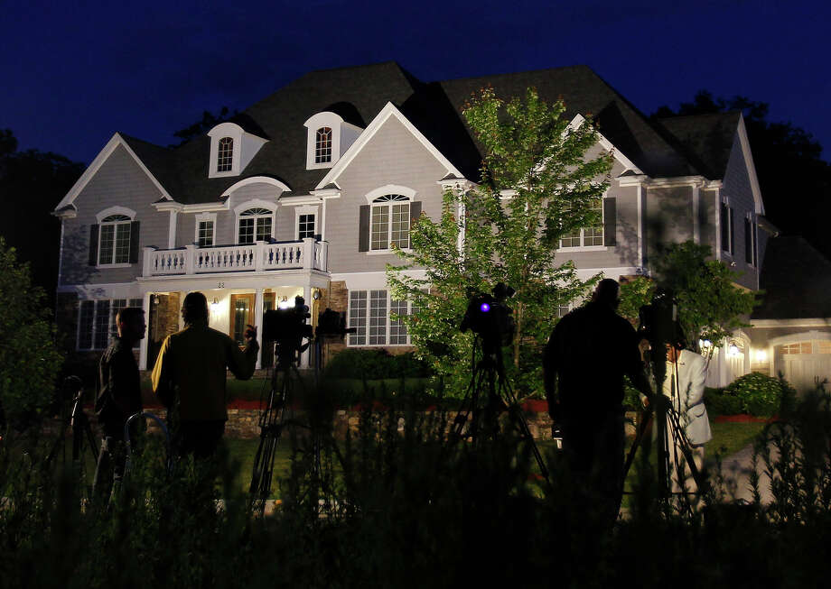 Media gather outside of New England Patriots player Aaron Hernandez's home in North Attleborough, Mass., June 19, 2013. Hernandez has been linked to the ongoing murder investigation of Odin Lloyd, 27, of Dorchester.  No charges have been filed against Hernandez. Photo: Boston Globe, Boston Globe Via Getty Images / 2013 - The Boston Globe