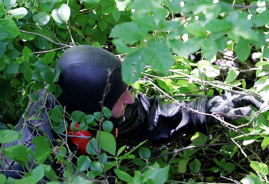 Massachusetts State Troopers search the woods along a street near Aaron Hernandez's home in North Attleborough, Mass., June 24, 2013. Hernandez, a New England Patriots player, has been linked to the ongoing murder investigation of Odin Lloyd, 27, of Dorchester.  No charges have yet been filed against Hernandez. Photo: Boston Globe, Boston Globe Via Getty Images / 2013 - The Boston Globe