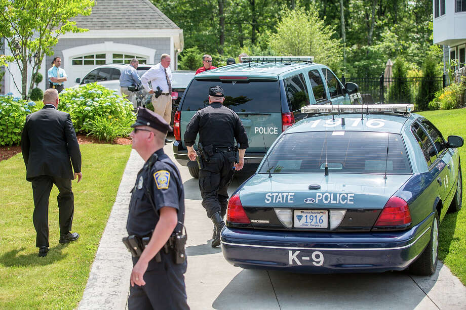 Police arrived at the home of Patriots player New England Patriots player Aaron Hernandez in North Attleborough. Hernandez has been linked to the ongoing murder investigation of Odin Lloyd, 27, of Dorchester.  No charges have yet been filed against Hernandez. Photo: Boston Globe, Boston Globe Via Getty Images / 2013 - The Boston Globe
