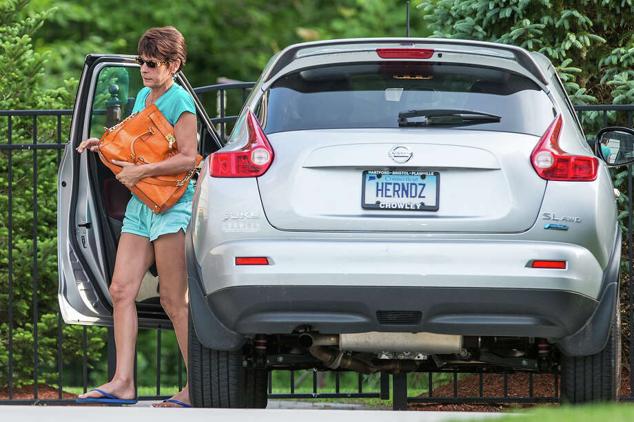 A woman, suspected to be the mother of Aaron Hernandez, arrived at the home of the New England Patriots in North Attleborough. Hernandez has been linked to the ongoing murder investigation of Odin Lloyd, 27, of Dorchester.  No charges have yet been filed against Hernandez. Photo: Boston Globe, Boston Globe Via Getty Images / 2013 - The Boston Globe