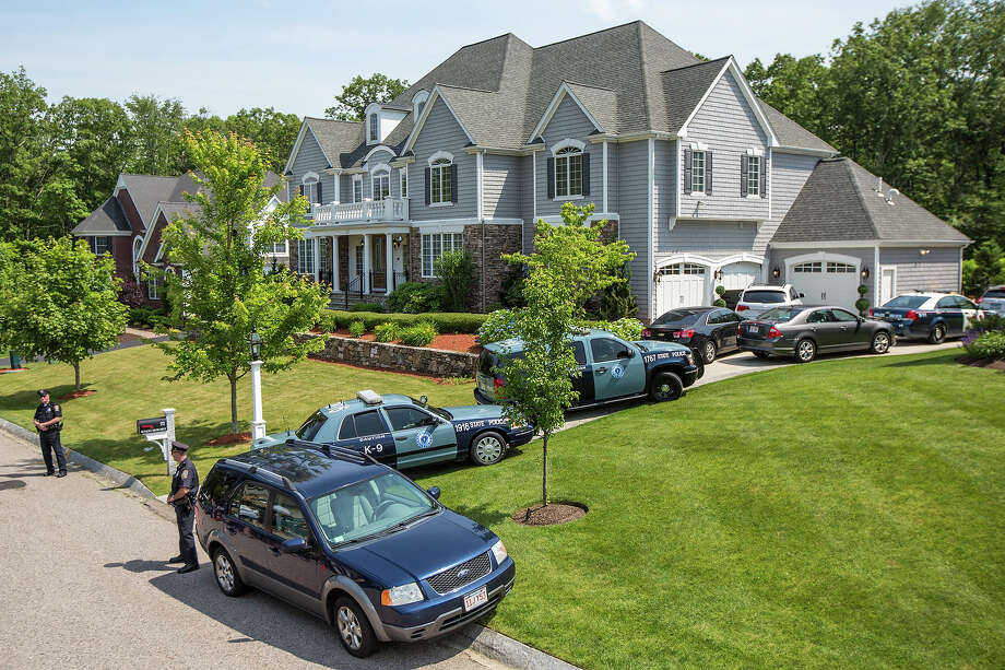 Police gathered at the home of New England Patriots player Aaron Hernandez in North Attleborough. Hernandez has been linked to the ongoing murder investigation of Odin Lloyd, 27, of Dorchester.  No charges have yet been filed against Hernandez. Photo: Boston Globe, Boston Globe Via Getty Images / 2013 - The Boston Globe