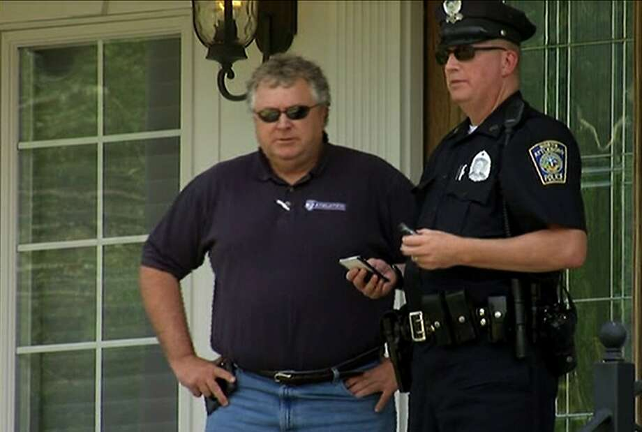 In this image taken from video, police officers talk outside of  the home of New England Patriots football player Aaron Hernandez, Saturday, June 22, 2013, in North Attleboro, Mass. State police officers and dogs searched Hernandez's home as they investigate the killing of Odin Lloyd, a semi-pro football player whose body was found nearby. Photo: ESPN