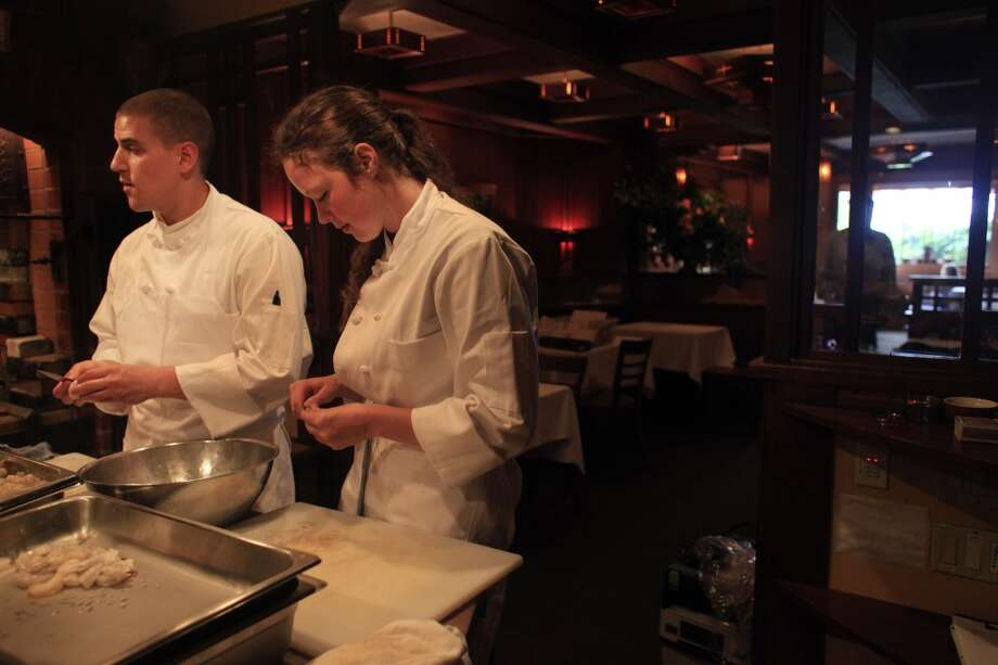 Culinary interns Chris Pappas and Amelia Lindbergh prep  for opening night.