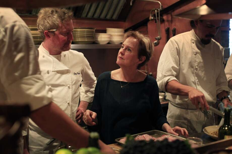 Chez Panisse Cafe Co-Chef Nathan Alderson by her side, Alice Waters tastes the first meals to go out on opening night.
