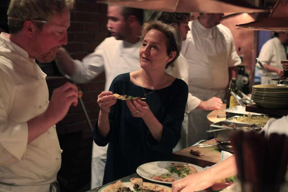 With Cafe Co-Chef Nathan Alderson by her side, Alice Waters tastes the first meals to go out on opening night.