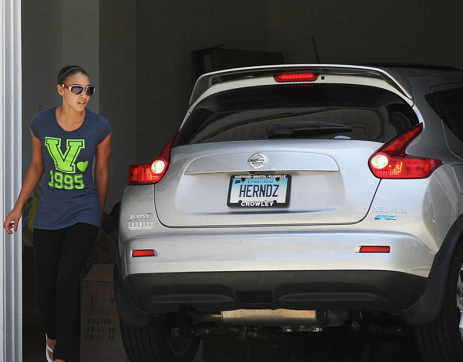 An unidentified woman prepared to leave the home of New England Patriots player Aaron Hernandez in North Attleborough, Mass., Friday, June 21, 2013. Hernandez has been linked to the ongoing murder investigation of Odin Lloyd, 27, of Dorchester.  No charges have been filed against Hernandez Photo: Boston Globe, Boston Globe Via Getty Images / 2013 - The Boston Globe