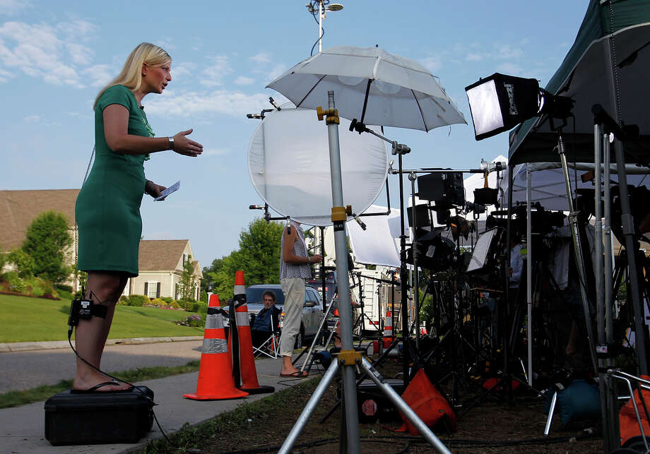 Media gather outside of Aaron Hernandez's home in North Attleborough, Mass., June 24, 2013. Hernandez, a New England Patriots player, has been linked to the ongoing murder investigation of Odin Lloyd, 27, of Dorchester.  No charges have yet been filed against Hernandez. Photo: Boston Globe, Boston Globe Via Getty Images / 2013 - The Boston Globe