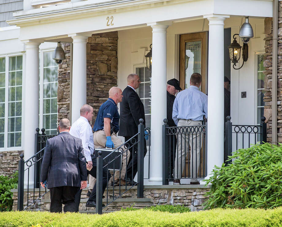 Police entered the home of New England Patriots player Aaron Hernandez in North Attleborough. Hernandez has been linked to the ongoing murder investigation of Odin Lloyd, 27, of Dorchester.  No charges have yet been filed against Hernandez. Photo: Boston Globe, Boston Globe Via Getty Images / 2013 - The Boston Globe