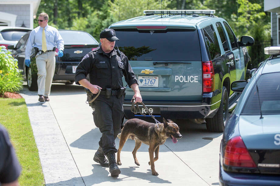 A State Police K-9 unit was brought inside the home of New England Patriots player Aaron Hernandez in North Attleborough. Hernandez has been linked to the ongoing murder investigation of Odin Lloyd, 27, of Dorchester.  No charges have yet been filed against Hernandez. Photo: Boston Globe, Boston Globe Via Getty Images / 2013 - The Boston Globe